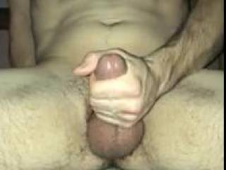 Stroking my lubed cock for a nice thick load.