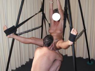 The love swing at our last swinger party.  The guys took turns at licking and fucking me whist I was restrained in the love swing.