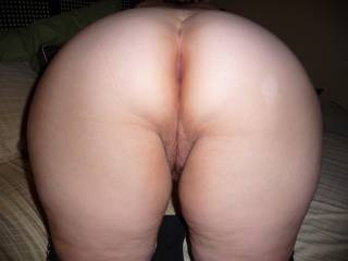 First I would drop to my knees and taste her sweet juices. Maybe give her a good slap or two. Then I would get up and by now my cock would be solid.With my cock I would slap her on that ass again. Then I would slide up on her and guide my stern cock deep into her moist slit. As I thrust I would reach under and tease her clit then only after she came I would release my load. Now the question is... do I cum in or out?
