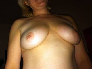 My wife teasing me with her tits, one of my biggest weaknesses...