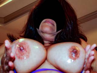 My tits are all oiled up...want to slip your cock in?