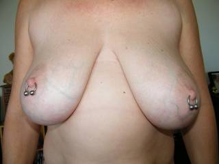 Love those pink nipples and those pierced titties...slid my 10 inch cock between them and let you rub em up and down till i blow my load all over your big titties..