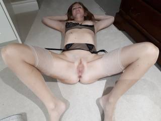 Lying around in lingerie, tits out and pussy ready for fucking