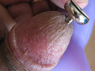 Using a clit vibrator to make the hardware go down feels so good.  It\'s almost all the way in now.