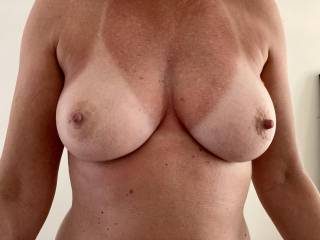 Tan lines, tits and nipples standing out!