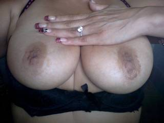 LOL QUICK SNAP SHOT OF THE MELONS!  AT A PUBLIC BATHROOM, ATTENDANT WAS LOOKING LOL!