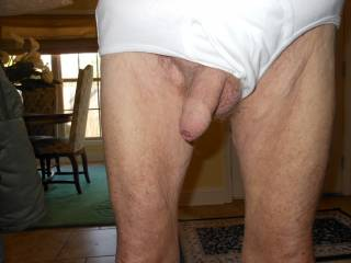 My uncut cock peeking out of my briefs... ready for a hot mouth!