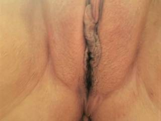 Besides her chubby cameltoe, I love the length of her clit slit. It is visible when standing and goes all the way to her butt hole.