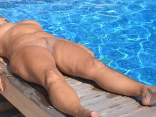Naked by the pool.