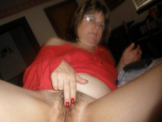 Lovely lady and such a beautiful hairy pussy.