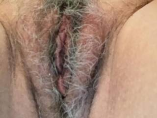 I love the color of your mature pussy hair.  I would love to part your lips and lick your clit all day long.