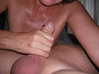 Playing with his lovely smooth cock.