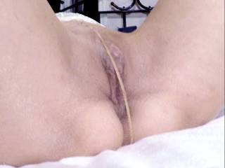 A little more of rubbing my clit seemed to arouse it and get my pussy starting to open up. That could possibly have something to do with my neighbor giving me some tongue through my hose also!
