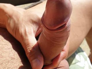 Kenny sunbathing, hoping a willing mouth will suck his hard dick 👄