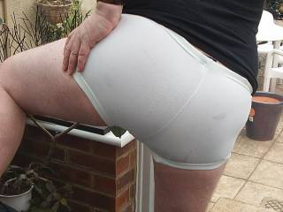 The curves of my ass cheeks and my crack as they fill out the tight white shorts I am wearing to accentuate my masculine bottom