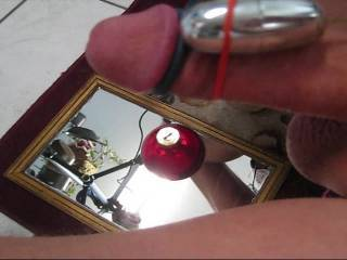 Cumming with my vibrator as the cum drips on an ornament hanging from my cock. Make sure to turn up your volume for the funny soundtrack.