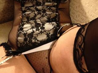 Spread open in her sheer panties