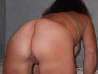 my tongue is all over that crack licking frantically both your gorgeous holes...as my hands cup, massage, squeeze, rob those hanging tits and nipples....feeling my cock getting hard and searching for pleasure......