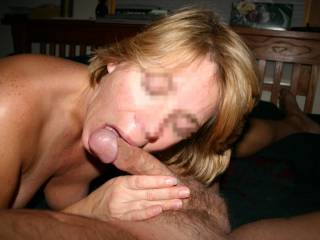 That is a real turn on.  She looks sexy sucking cock!  Keep posting your hot pics.  I'm a fan