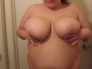 OMG i want to feell my cock slide between her titties n cum. also i would enjoy feeling her sweet pussy as i slide into her n cum too. wow she gets me so hard