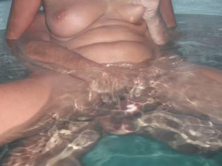 Riding our swinger friend's lovely cock in the spa at home, when he came around for a play again.