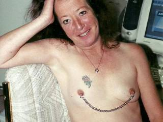 """I love small tits pulled out into a cone shape...any chance of that here?  Thanks, they are really horney pierced, ringed and linked.  My GF has a chain that she passes around the back of her neck and pulls her nips into a """"point up"""" position....does it for me."""