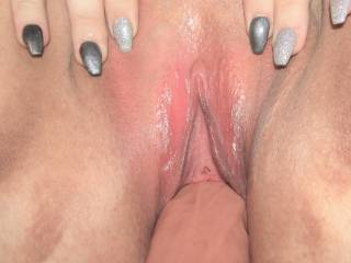 Mmmm, filled nice and deep with a big toy - if only I had someone to lick and nibble on my little pink clit - anybody wanna go first?