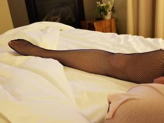 Mistress Wifey\'s sexy legs and feet in thigh highs. Anyone have a foot fetish?