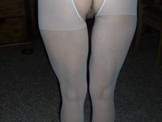 Your arse looks incredible in crotchless pantyhose! I'd love to rest my thick cock between your ass cheeks.