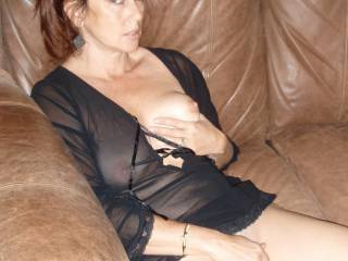 Candi Annie glances toward the camera to see if everyone is watching her play with her pussy... and squeeze her titty