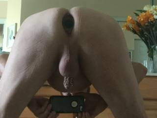 me doing a selfie showing my glass butt plug and piercings