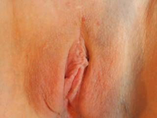 here is another shot of her pussy. She really wants you to post a picture of your cum on her photo. She wants to think about you fucking her.