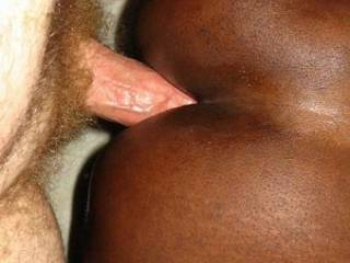 Nice white cock reaming that black ass.  Wish it were mine