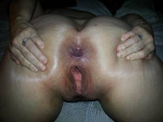 This pic instantly goes into my TOTALLY AWESOME PICS folder.  Both holes look extremely fuckable.