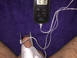 Still shot of my first electrosex setup showing my Omron stimulator and the large sticky pads on my cock.  I've come such a long way since this day!
