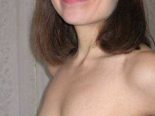 Wife smiling with her saggy tits.