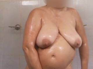 I took a shower at work and a colleague looked at me through a hole.  Knowing that someone was looking at me, I got really horny and rubbed my pussy.  I'm convinced he rubbed his cock the way he looked at me