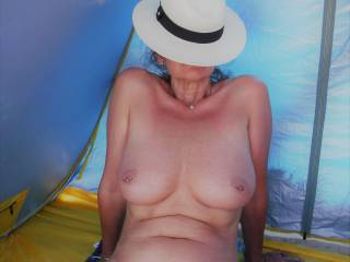 Sheltering from the intense midday sun on a local nude beach.