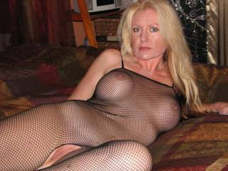You are very sultry hottt and so seductive in those fishnets!! A huge turn on!! Love your fantastic tits and awesome nipples poking thru the net, mmmmmmmm makes me want to run my tongue around them, nibble and suck em'!! MMMMMM and such a beautiful hot smooth succulent pussy mmmmmmmmmmm so inviting for my tongue to give you a long erotic deep licking wanting you to cum so hard drenching my tongue with your sweetness!! MMMMMMMMMMMMMM Delicious!!