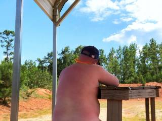 A day shooting at the range. I decided to shoot a little while naked. It's more fun that way. Yes, this is a public range. The back is open to a road separating the shooting points. I was totally visible from that road.
