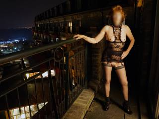 Risky posing out on the hotel balcony at night