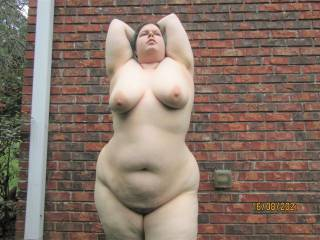 My beautiful wife posing for the camera as she shows off her curvy naked body outdoors. The neighbours did themselves a disservice not looking out their windows!