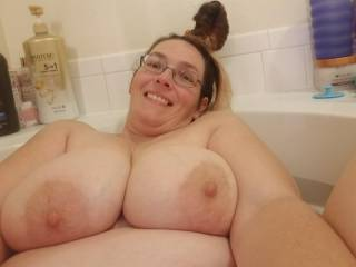 Bathtime titty shot with a messy bun and all.