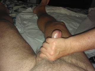 Nice hand job from the Mrs.  She uses coconut oil to lube things.  This is her overhand grip. with cumming about to shoot.