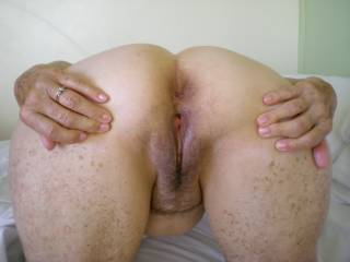 Bent over spreading big pussy waiting for a nice cock to fill it