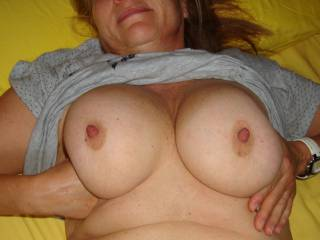 they are big with sweet little palee pink areola round those organ stop nipples I'd love to  suck