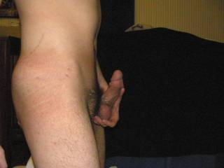 Masturbating while playing with and stretching my balls.
