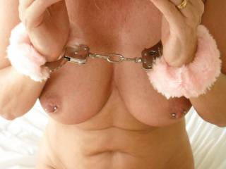 Those pierced nipples would certainly be getting licked, flicked, and teased for a starters if it was down to me....He is one seriously lucky guy to have you all chained up and ready for action....Stunning! :)
