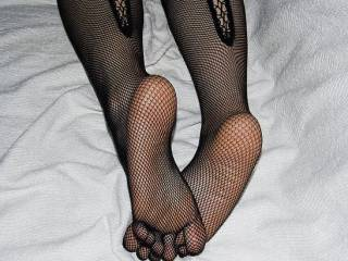 Taking off my heels from work and putting on my fishnet stockings...time for play;-)