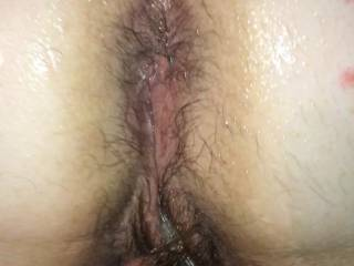 Getting my hairy pussy and butt covered in oil ready for a good hard fucking  Any volunteers?